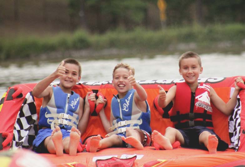 Boys tubing on lake